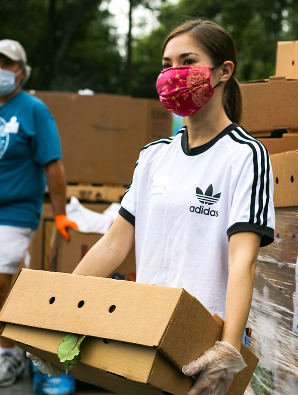 Volunteer with mask at food distribution